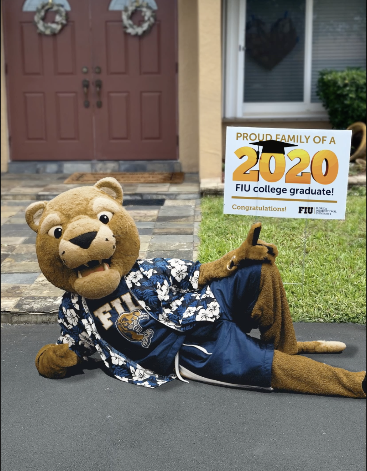 Roary with an FIU Grad Yard Sign